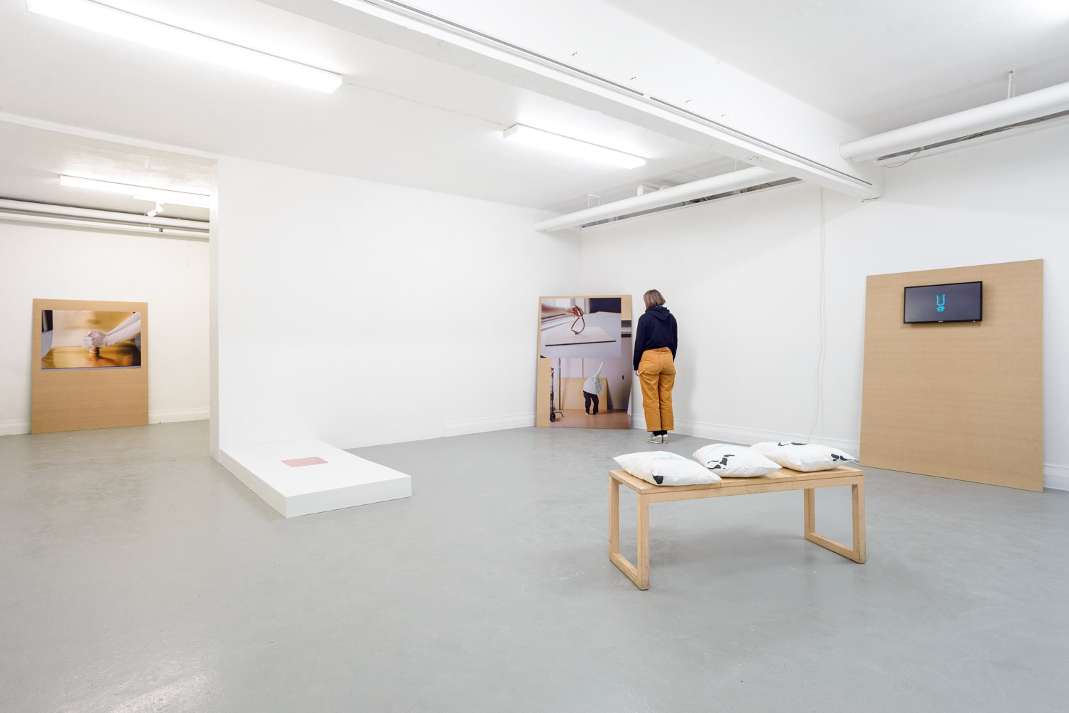 contemporary art installation in a white gallery and a visitor