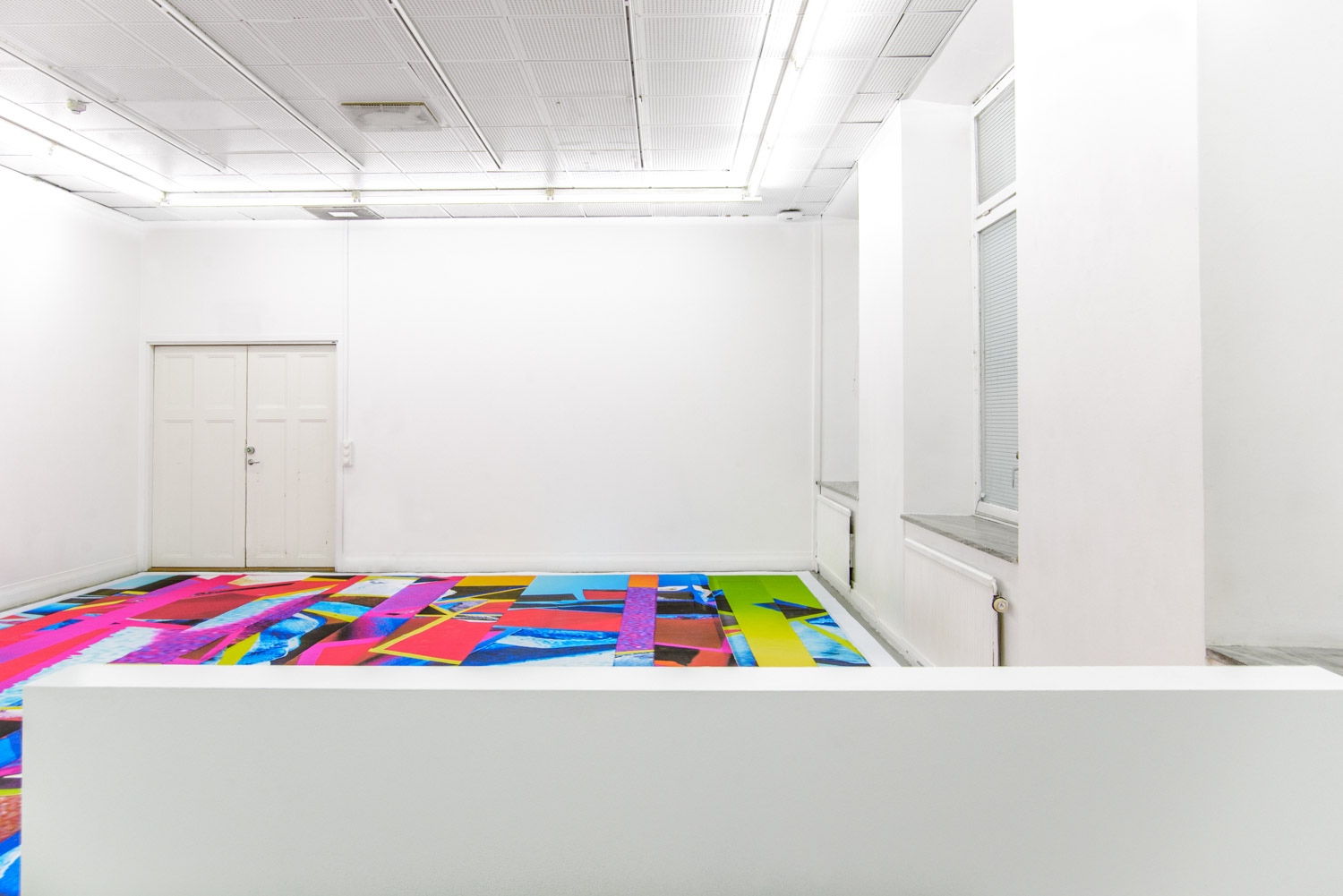 contemporary colorful carpet as an art installation by Stefano Conti in a white gallery