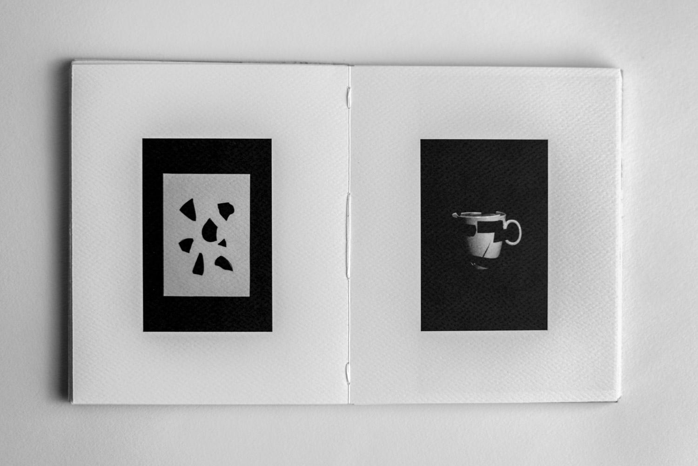 broken mug and pieces in the Artist Book - Stefano Conti