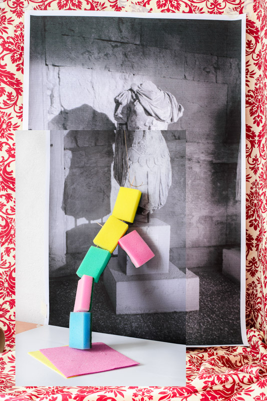 greek statue in front of colored sponges, by artist Stefano Conti