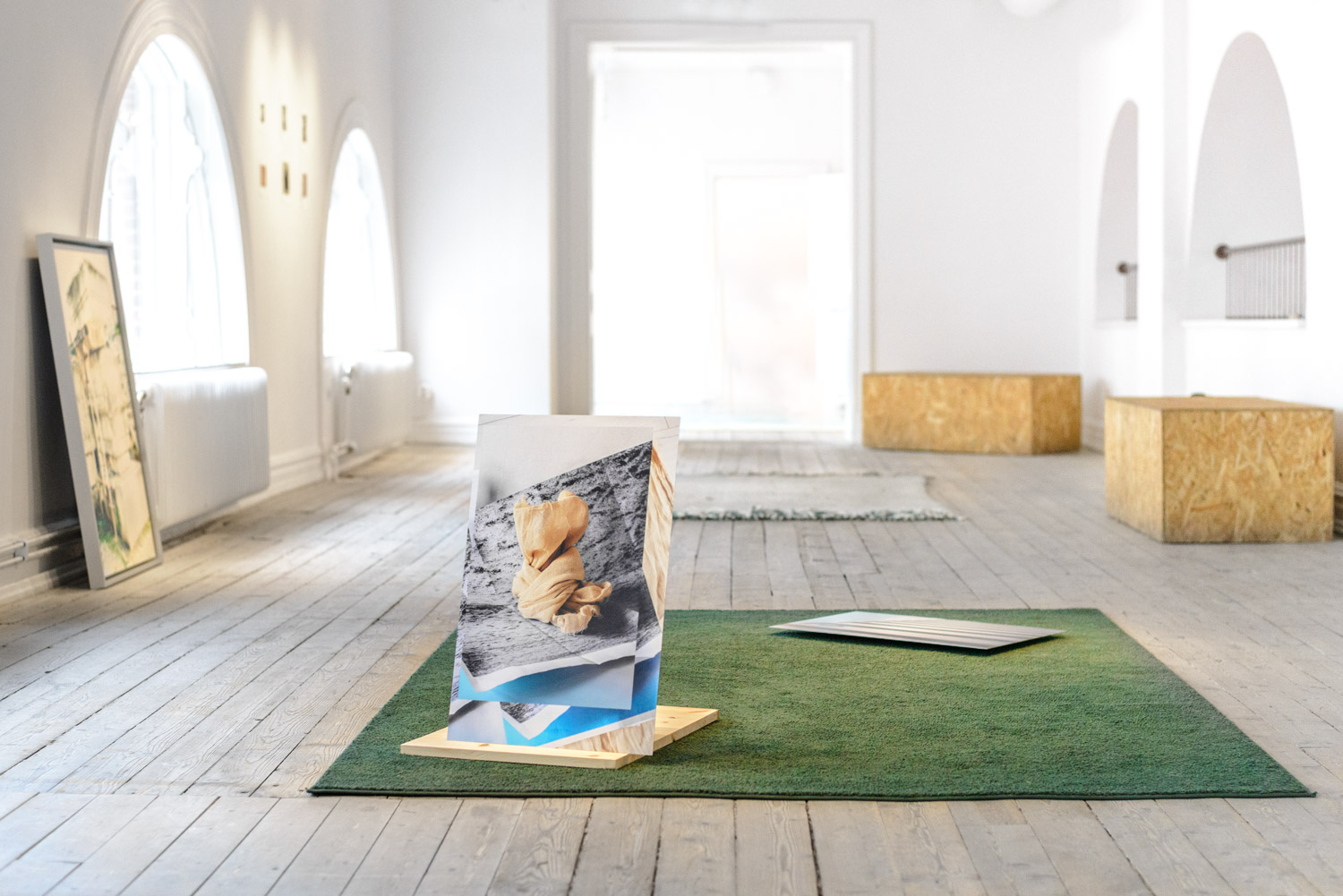 contemporary art installation with photographs on the floor, by Artist Stefano Conti