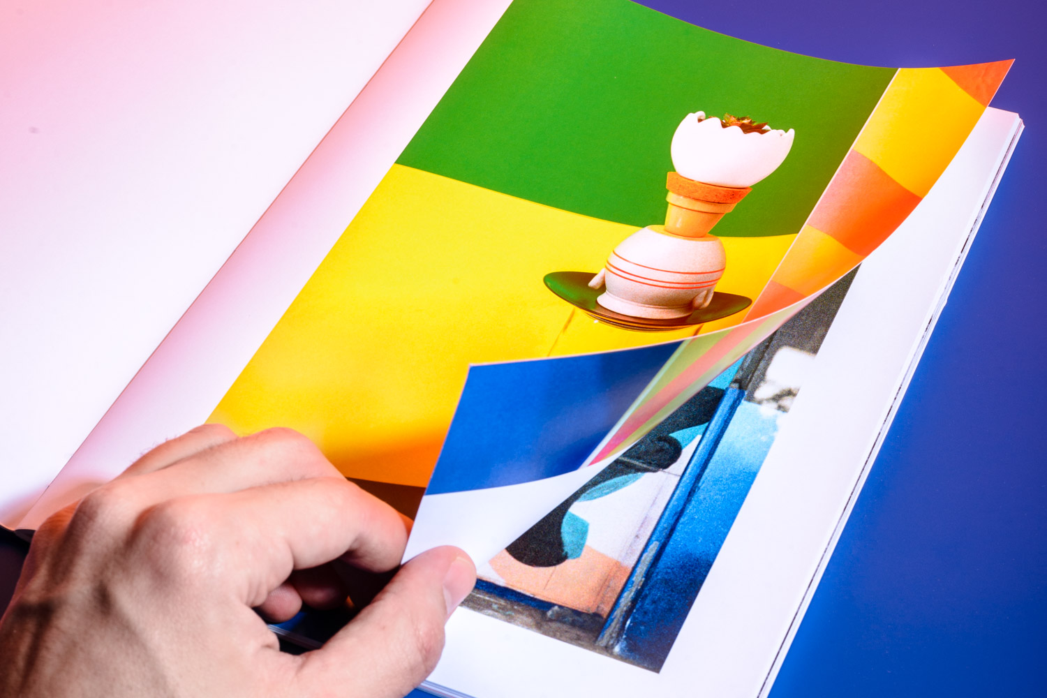 hand flips through the Zine by Stefano Conti